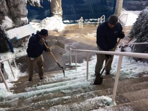 Chipping at ice on the stairways