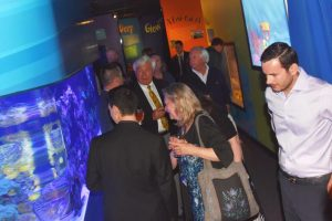 Guests enjoy Coral Reef tanks and other parts of exhibit